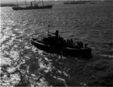 Thumbnail of Mail boat returning to pier